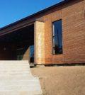 Fachada de Bibloteca UACH con madera modifica da